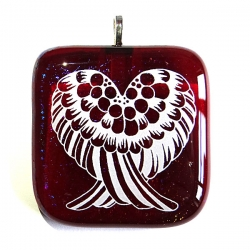 Angel wings pendant on sparkling red glass
