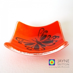 Butterfly bowl in blended red and orange fused glass