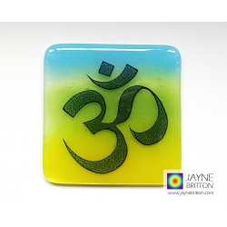 Om coaster - indigo on blue, yellow, green blended background