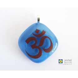 Om pendant on Egyptian blue fused glass