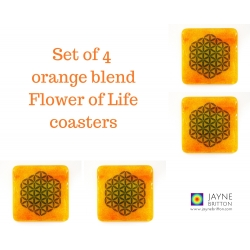 Set of four Flower of Life coasters - deep blue on yellow and orange blended background