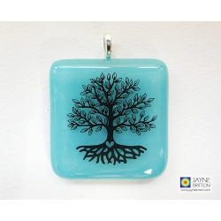 Tree of Life pendant on turquoise blue fused glass