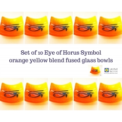 Ten Eye of Horus bowls in orange yellow blended fused glass
