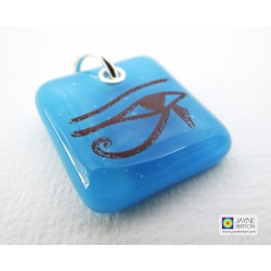 Eye of Horus pendant on light blue fused glass
