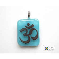 Om pendant on turquoise glass