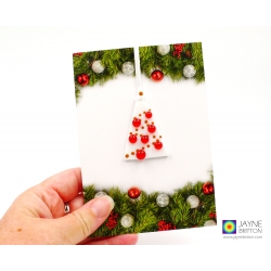 Christmas card with gift, fused glass christmas tree decoration, orange baubles