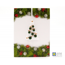 Christmas card with gift, sparkly green and white christmas tree decoration