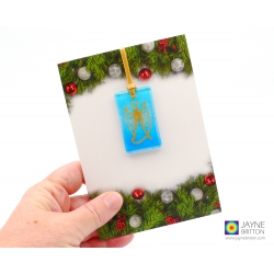 Christmas card with gift, blue angel tree decoration, guardian angel, archangel michael