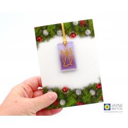Christmas card with gift, purple angel tree decoration, guardian angel, archangel zadkiel