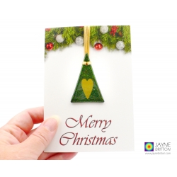 Christmas card with gift, sparkly green christmas tree decoration with gold heart