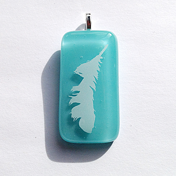 Angel feather on handmade glass in turquoise