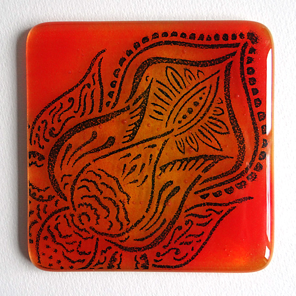 Lotus flower coaster in deep blue on yellow, orange and red