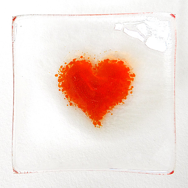 Orange heart bowl in clear glass