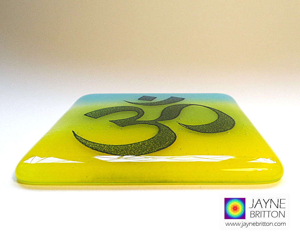 Om coaster - indigo on blue, yellow, green blended background