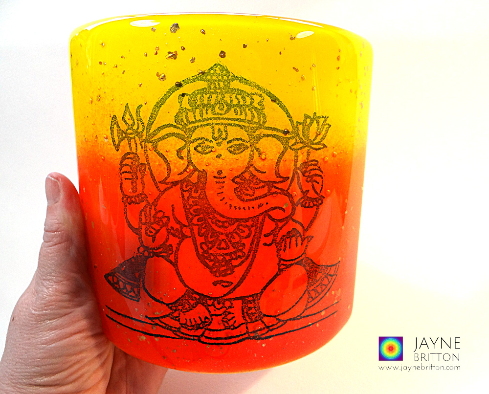 Ganesh Sconce - fused glass screen - red orange yellow