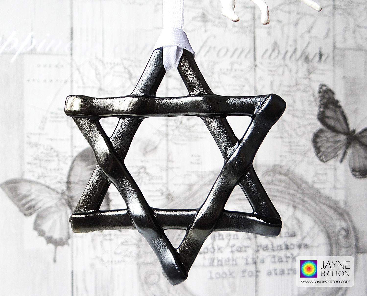 Iridescent silver and black star, light catcher, hanging decoration